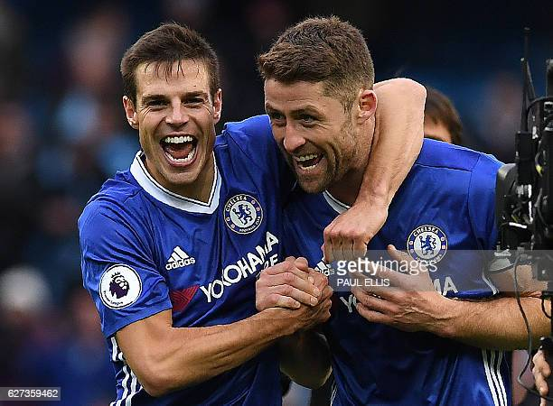 Chelsea's Spanish defender Cesar Azpilicueta and Chelsea's English defender Gary Cahill celebrate following the English Premier League football match...