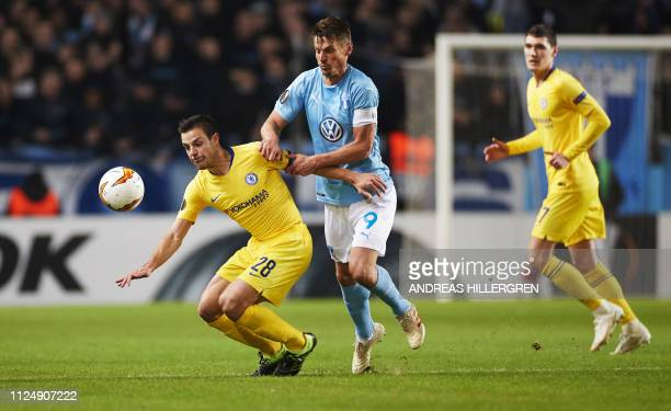 Chelsea's Spanish defender Cesar Azpilicueta and Malmo's Markus Rosenberg vie for the ball during the UEFA Europa League round of 32 firstleg...