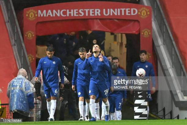 Chelsea's Spanish defender Cesar Azpilicueta and teammates walk onto the pitch during the English Premier League football match between Manchester...