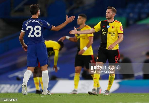 Chelsea's Spanish defender Cesar Azpilicueta and Watford's English mifielder Tom Cleverley after the English Premier League football match between...