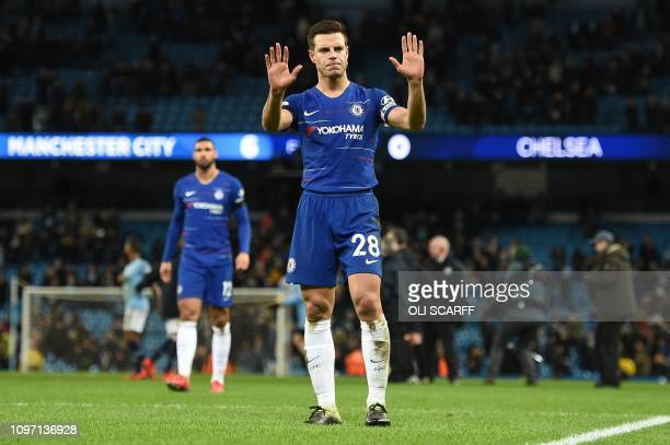 Chelsea's Spanish defender Cesar Azpilicueta applauds the fans following the English Premier League football match between Manchester City and...