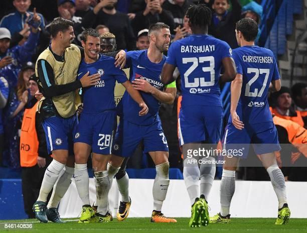 Chelsea's Spanish defender Cesar Azpilicueta celebrates scoring his team's third goal during the UEFA Champions League Group C football match between...