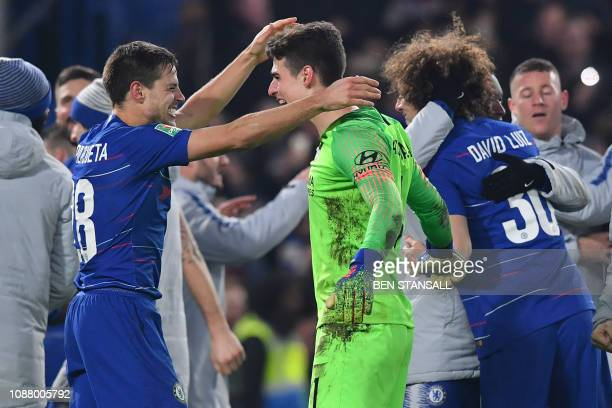 Chelsea's Spanish defender Cesar Azpilicueta celebrates with Chelsea's Spanish goalkeeper Kepa Arrizabalaga on the pitch after winning the penalty...
