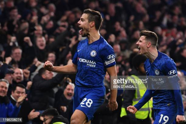 Chelsea's Spanish defender Cesar Azpilicueta celebrates with Chelsea's English midfielder Mason Mount after scoring his team's second goal during the...