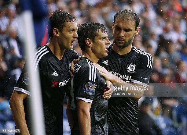 Chelsea's Spanish defender Cesar Azpilicueta celebrates with Chelsea's Serbian midfielder Nemanja Matic and Chelsea's Serbian defender Branislav...