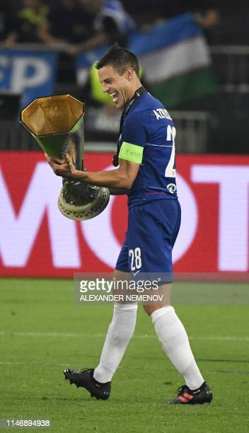 Chelsea's Spanish defender Cesar Azpilicueta celebrates with the trophy after the UEFA Europa League final football match between Chelsea FC and...