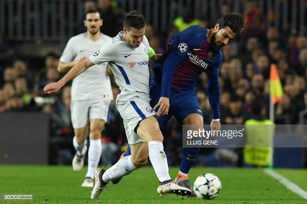 Chelsea's Spanish defender Cesar Azpilicueta challenges Barcelona's Portuguese midfielder Andre Gomes during the UEFA Champions League round of...