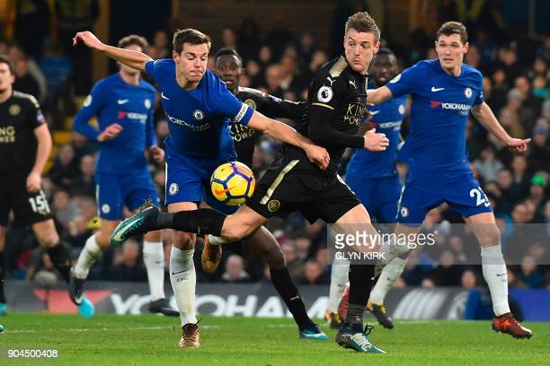 Chelsea's Spanish defender Cesar Azpilicueta challenges Leicester City's English striker Jamie Vardy during the English Premier League football match...