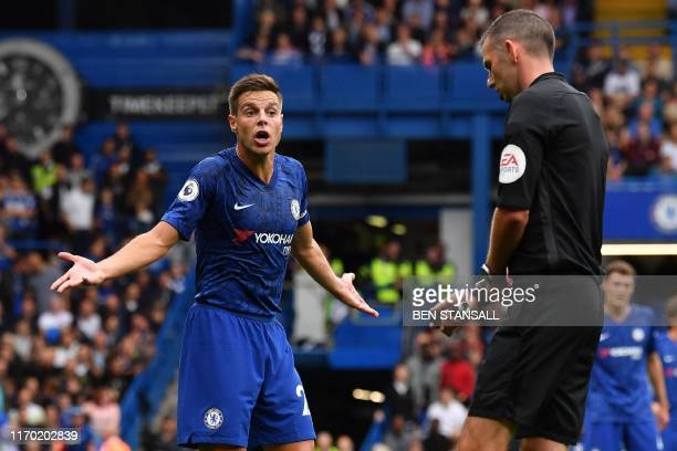 Chelsea's Spanish defender Cesar Azpilicueta gestures to English referee Michael Oliver during the English Premier League football match between...