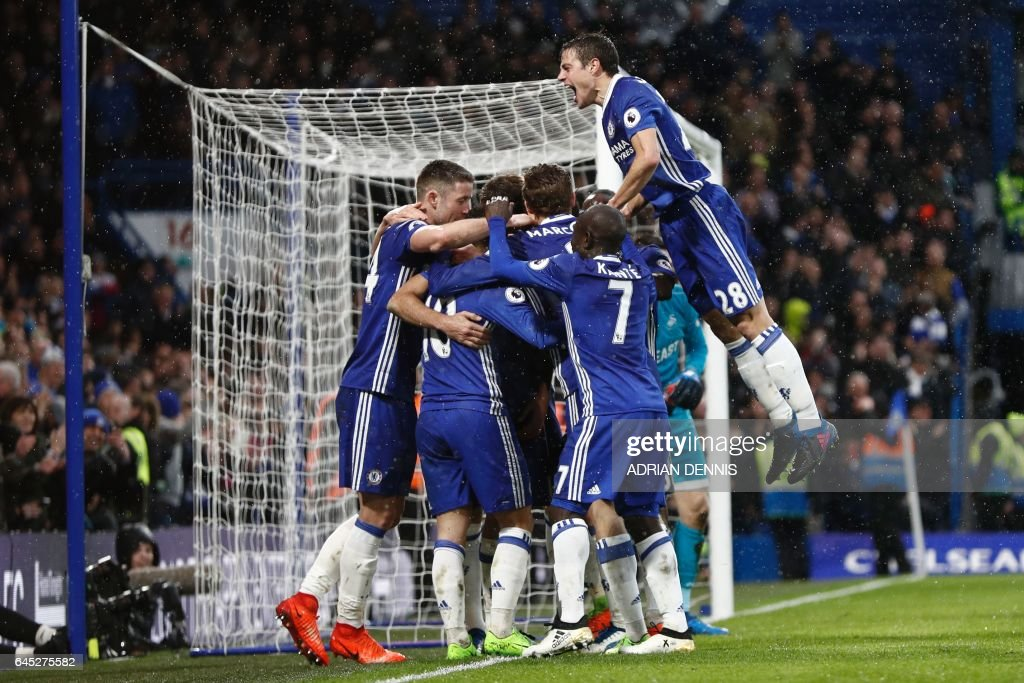 Chelsea's Spanish defender Cesar Azpilicueta (R) jumps in to join the celebration after Chelsea's Brazilian-born Spanish striker Diego Costa scored their third goal during the English Premier League football match between Chelsea and Swansea at Stamford Bridge in London on February 25, 2017. / AFP / Adrian DENNIS / RESTRICTED TO EDITORIAL USE. No use with unauthorized audio, video, data, fixture lists, club/league logos or 'live' services. Online in-match use limited to 75 images, no video emulation. No use in betting, games or single club/league/player publications. /