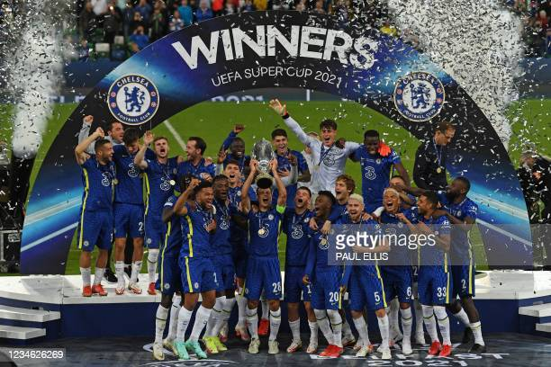 Chelsea's Spanish defender Cesar Azpilicueta raises the trophy during the presentation ceremony after Chelsea won the UEFA Super Cup football match...