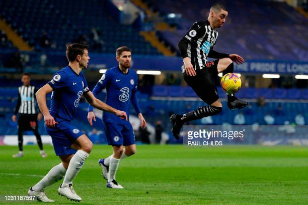 Chelsea's Spanish defender Cesar Azpilicueta reacts as Newcastle United's Paraguayan midfielder Miguel Almiron jumps to control the ball during the...
