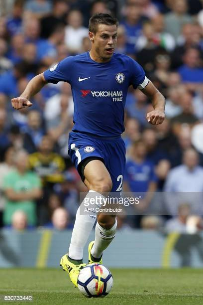 Chelsea's Spanish defender Cesar Azpilicueta runs with the ball during the English Premier League football match between Chelsea and Burnley at...