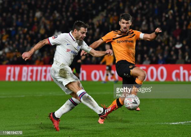 Chelsea's Spanish defender Cesar Azpilicueta shoots past Hull City's US defender Eric Lichaj during the English FA Cup fourth round football match...