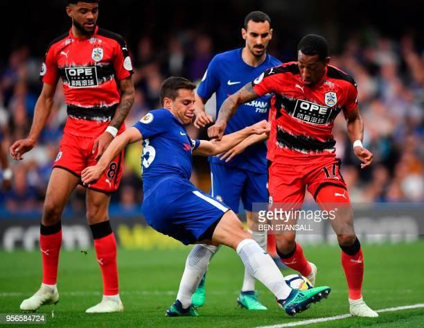 Chelsea's Spanish defender Cesar Azpilicueta tackles Huddersfield Town's Dutch midfielder Rajiv van La Parra during the English Premier League...