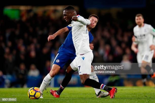 Chelsea's Spanish defender Cesar Azpilicueta tangles with Crystal Palace's Zaireborn Belgian striker Christian Benteke during the English Premier...