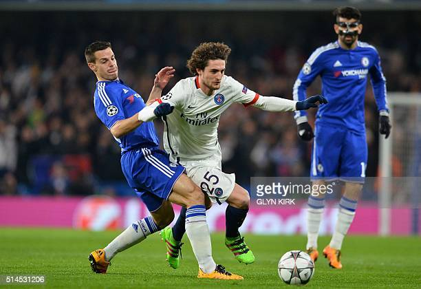 Chelsea's Spanish defender Cesar Azpilicueta tries to tackle Paris SaintGermain's French midfielder Adrien Rabiot during the UEFA Champions League...