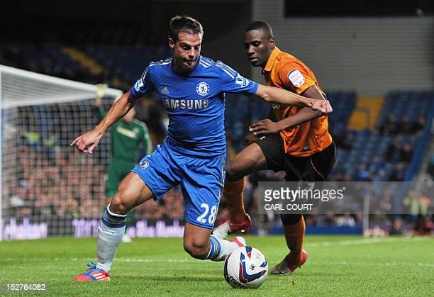Chelsea's Spanish defender Cesar Azpilicueta vies for the ball with Wolverhampton Wanderers' French midfielder Razak Boukari during the third round...