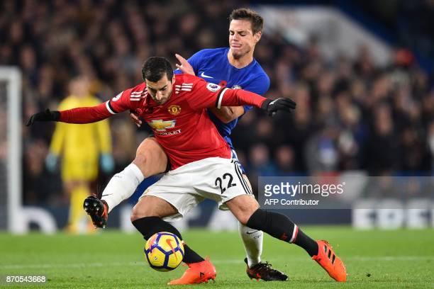 Chelsea's Spanish defender Cesar Azpilicueta vies with Manchester United's Armenian midfielder Henrikh Mkhitaryan during the English Premier League...