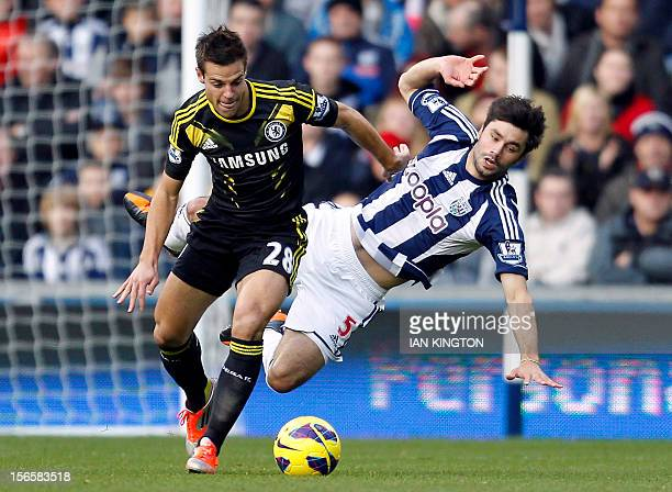 Chelsea's Spanish defender Cesar Azpilicueta vies with West Bromwich Albion's Argentinian midfielder Claudio Yacob during an English Premier League...