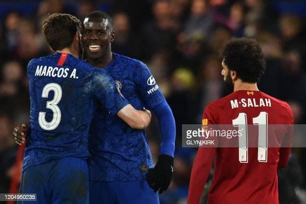 Chelsea's Spanish defender Marcos Alonso and Chelsea's French defender Kurt Zouma celebrate as Liverpool's Egyptian midfielder Mohamed Salah walks...