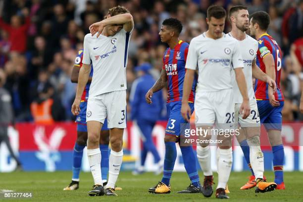 Chelsea's Spanish defender Marcos Alonso and teammates react to their defeat on the pitch after the English Premier League football match between...