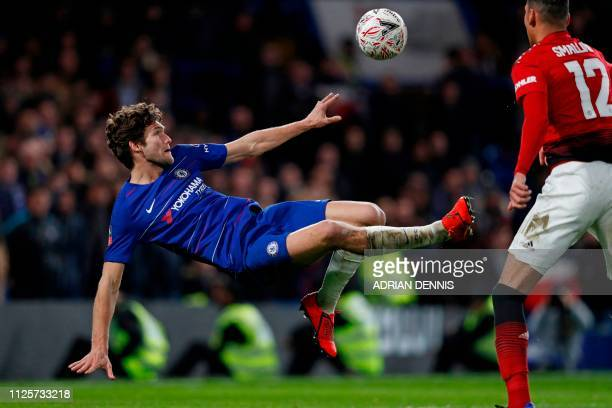 Chelsea's Spanish defender Marcos Alonso attempts an overhead kick during the English FA Cup fifth round football match between Chelsea and...