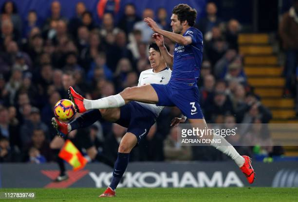 Chelsea's Spanish defender Marcos Alonso blocks a cross from Tottenham Hotspur's South Korean striker Son HeungMin during the English Premier League...