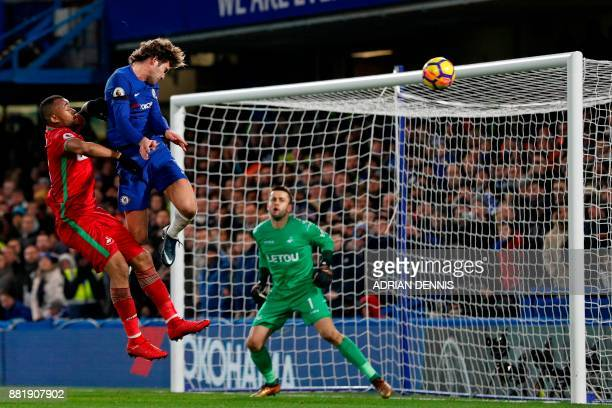 Chelsea's Spanish defender Marcos Alonso cannot direct his header at the goal during the English Premier League football match between Chelsea and...