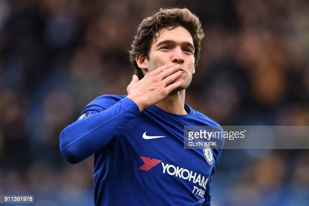Chelsea's Spanish defender Marcos Alonso celebrates after scoring their third goal during the English FA Cup fourth round football match between...