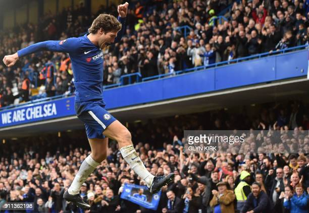 TOPSHOT Chelsea's Spanish defender Marcos Alonso celebrates after scoring their third goal during the English FA Cup fourth round football match...