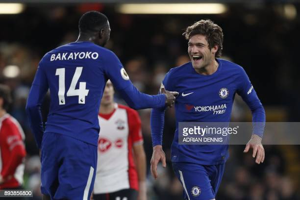 Chelsea's Spanish defender Marcos Alonso celebrates after scoring with Chelsea's French midfielder Tiemoue Bakayoko during the English Premier League...