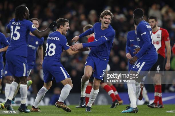 Chelsea's Spanish defender Marcos Alonso celebrates after scoring with Chelsea's French midfielder Tiemoue Bakayoko and Chelsea's Spanish defender...