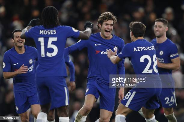 Chelsea's Spanish defender Marcos Alonso celebrates after scoring with Chelsea's Nigerian midfielder Victor Moses and Chelsea's Spanish defender...