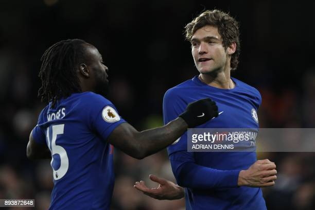Chelsea's Spanish defender Marcos Alonso celebrates after scoring with Chelsea's Nigerian midfielder Victor Moses during the English Premier League...