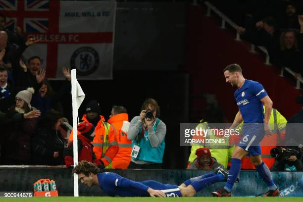 Chelsea's Spanish defender Marcos Alonso celebrates after scoring with Chelsea's English midfielder Danny Drinkwater during the English Premier...