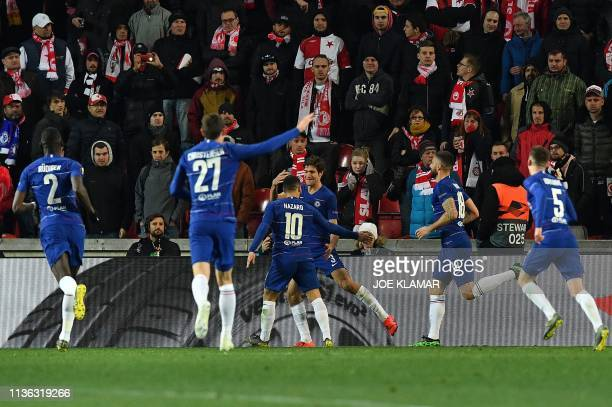 Chelsea's Spanish defender Marcos Alonso celebrates scoring the opening goal with his teammates during the UEFA Europa League quarterfinal first leg...