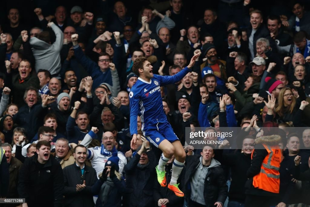 Chelsea's Spanish defender Marcos Alonso celebrates scoring the opening goal during the English Premier League football match between Chelsea and Arsenal at Stamford Bridge in London on February 4, 2017. / AFP / Adrian DENNIS / RESTRICTED TO EDITORIAL USE. No use with unauthorized audio, video, data, fixture lists, club/league logos or 'live' services. Online in-match use limited to 75 images, no video emulation. No use in betting, games or single club/league/player publications. /