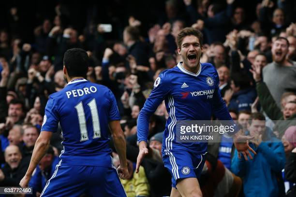 Chelsea's Spanish defender Marcos Alonso celebrates scoring the opening goal during the English Premier League football match between Chelsea and...