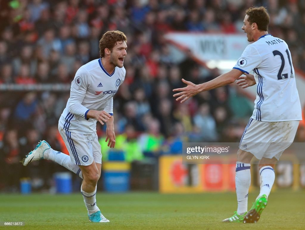 Chelsea's Spanish defender Marcos Alonso (L) celebrates scoring their third goal from a free kick during the English Premier League football match between Bournemouth and Chelsea at the Vitality Stadium in Bournemouth, southern England on April 8, 2017. / AFP PHOTO / Glyn KIRK / RESTRICTED TO EDITORIAL USE. No use with unauthorized audio, video, data, fixture lists, club/league logos or 'live' services. Online in-match use limited to 75 images, no video emulation. No use in betting, games or single club/league/player publications. /