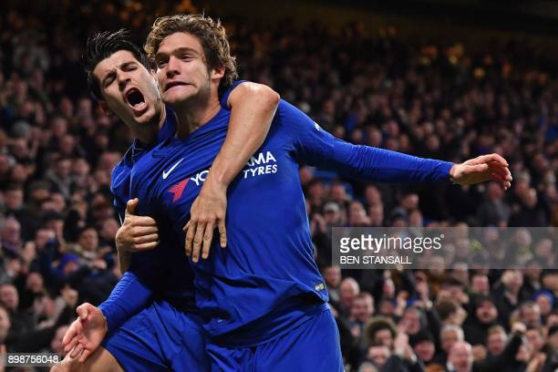 Chelsea's Spanish defender Marcos Alonso celebrates with Chelsea's Spanish striker Alvaro Morata after scoring their second goal during the English...