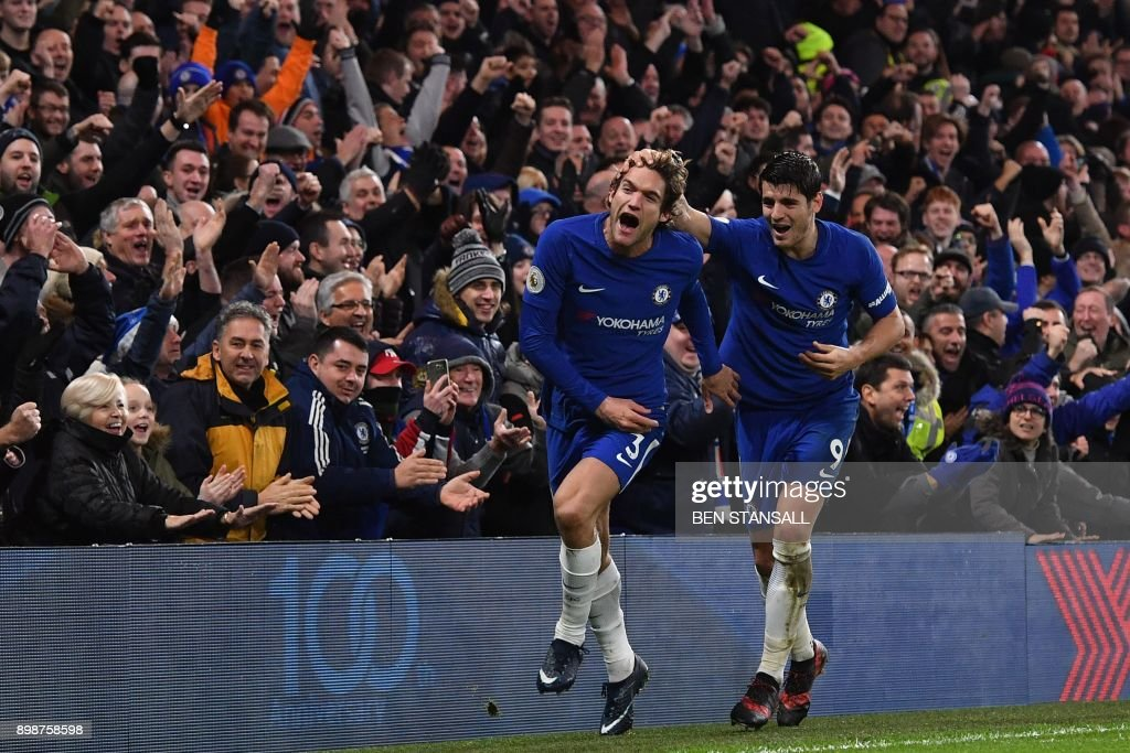TOPSHOT - Chelsea's Spanish defender Marcos Alonso celebrates with Chelsea's Spanish striker Alvaro Morata (R) after scoring their second goal during the English Premier League football match between Chelsea and Brighton and Hove Albion at Stamford Bridge in London on December 26, 2017. / AFP PHOTO / Ben STANSALL / RESTRICTED TO EDITORIAL USE. No use with unauthorized audio, video, data, fixture lists, club/league logos or 'live' services. Online in-match use limited to 75 images, no video emulation. No use in betting, games or single club/league/player publications. /