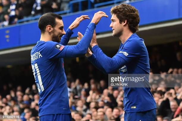Chelsea's Spanish defender Marcos Alonso celebrates with Chelsea's Italian defender Davide Zappacosta after scoring their third goal during the...