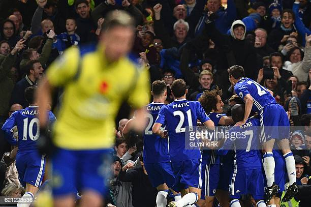 Chelsea's Spanish defender Marcos Alonso celebrates with teammates after scoring their second goal during the English Premier League football match...