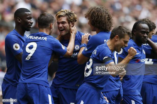 Chelsea's Spanish defender Marcos Alonso celebrates with teammates scoring the team's first goal during the English Premier League football match...