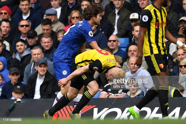Chelsea's Spanish defender Marcos Alonso clashes with Watford's English midfielder Will Hughes after a challenge during the English Premier League...