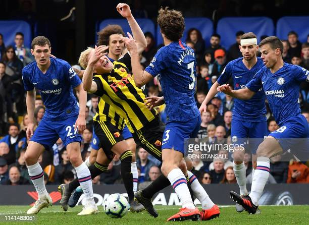 Chelsea's Spanish defender Marcos Alonso clashes with Watford's English midfielder Will Hughes during the English Premier League football match...