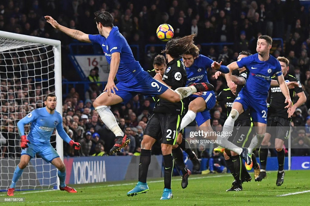 TOPSHOT - Chelsea's Spanish defender Marcos Alonso (C) directs this header past Brighton's Australian goalkeeper Mathew Ryan (L) to score their second goal during the English Premier League football match between Chelsea and Brighton and Hove Albion at Stamford Bridge in London on December 26, 2017. / AFP PHOTO / Ben STANSALL / RESTRICTED TO EDITORIAL USE. No use with unauthorized audio, video, data, fixture lists, club/league logos or 'live' services. Online in-match use limited to 75 images, no video emulation. No use in betting, games or single club/league/player publications. /