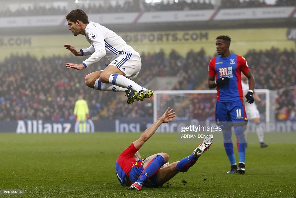 TOPSHOT - Chelsea's Spanish defender Marcos Alonso (L) hurdles a challenge from Crystal Palace's French midfielder Yohan Cabaye (C) during the English Premier League football match between Crystal Palace and Chelsea at Selhurst Park in south London on December 17, 2016. / AFP / Adrian DENNIS / RESTRICTED TO EDITORIAL USE. No use with unauthorized audio, video, data, fixture lists, club/league logos or 'live' services. Online in-match use limited to 75 images, no video emulation. No use in betting, games or single club/league/player publications. /