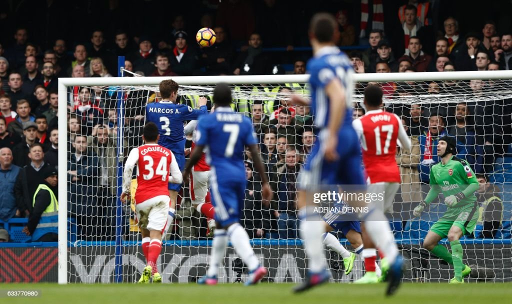 Chelsea's Spanish defender Marcos Alonso (2L) rises above Arsenal's Spanish defender Hector Bellerin (3L) to score the opening goal during the English Premier League football match between Chelsea and Arsenal at Stamford Bridge in London on February 4, 2017. / AFP / Adrian DENNIS / RESTRICTED TO EDITORIAL USE. No use with unauthorized audio, video, data, fixture lists, club/league logos or 'live' services. Online in-match use limited to 75 images, no video emulation. No use in betting, games or single club/league/player publications. /
